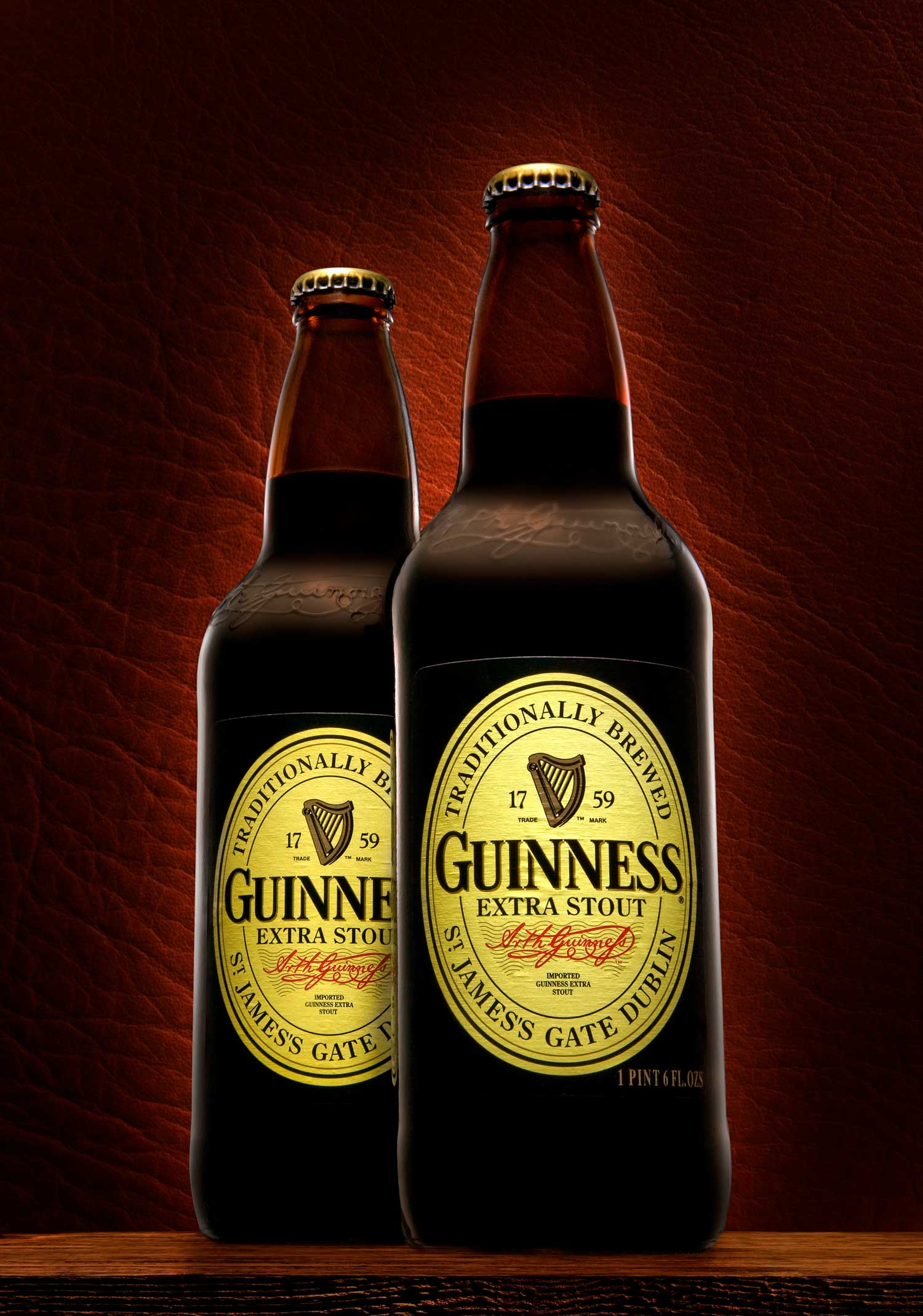 2 guinness bottles blurred background