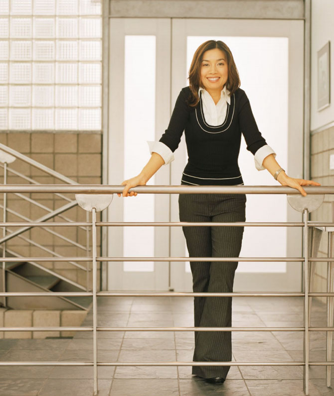 Photography_Business and Travel_Business Woman on Railing-Tony Garcia