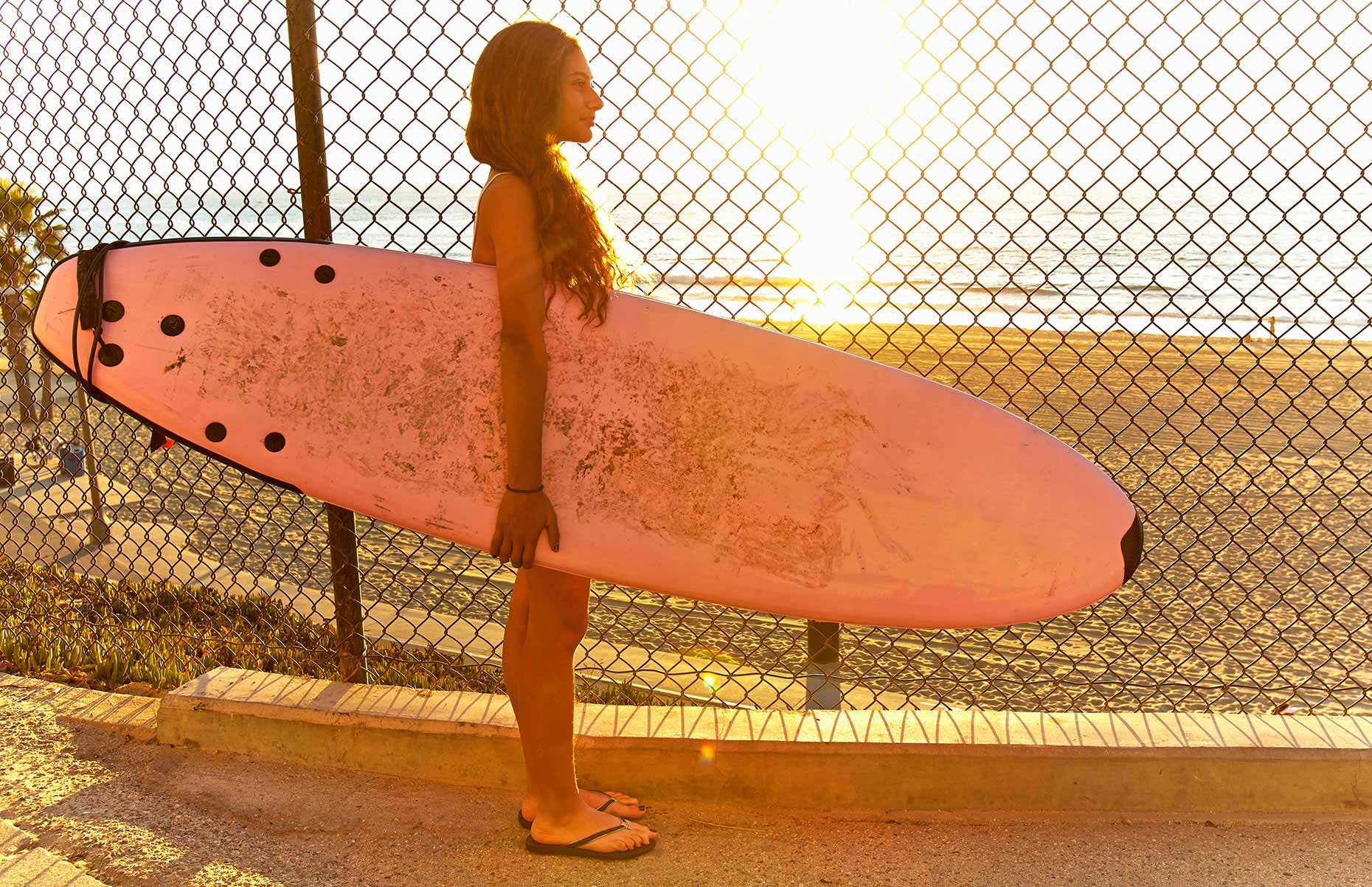 Photography_Children and Teens_Girl with Pink Surfboard-Tony Garcia