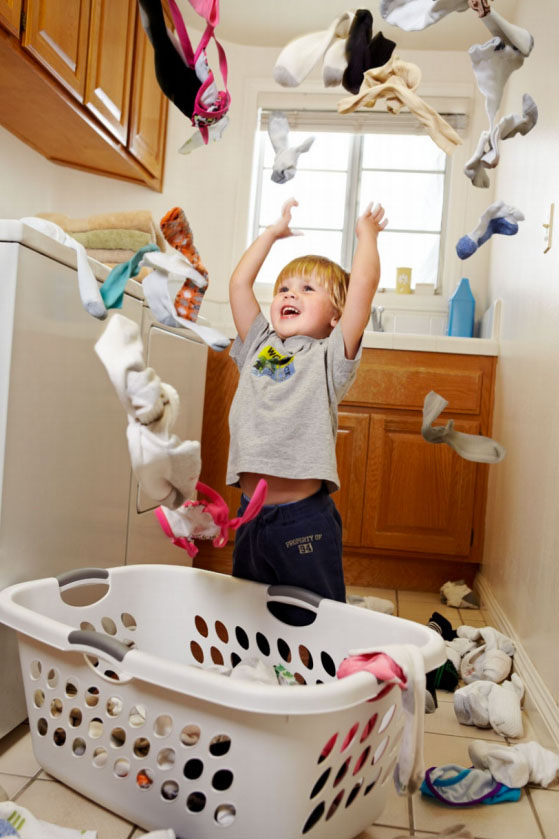 Photography_Children and Teens_Boy Menace Throwing Laundry-Tony Garcia