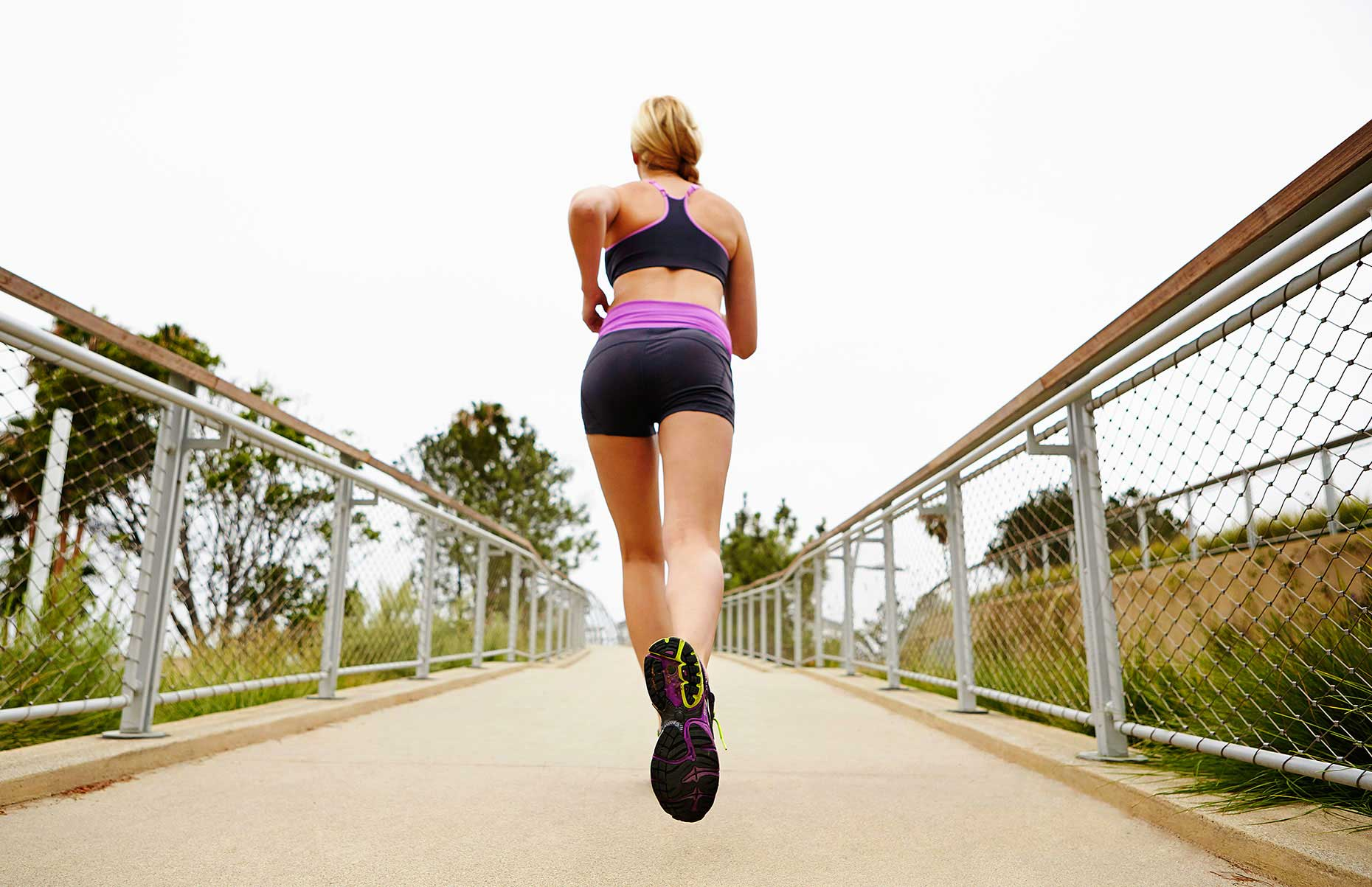 Photography_Sports and Fitness_Blond Woman Jogging on Walkway-Tony Garcia