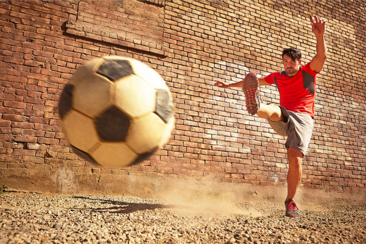 Photography_Sports and Fitness_Guy Kicking Soccer Ball Red Shirt-Tony Garcia