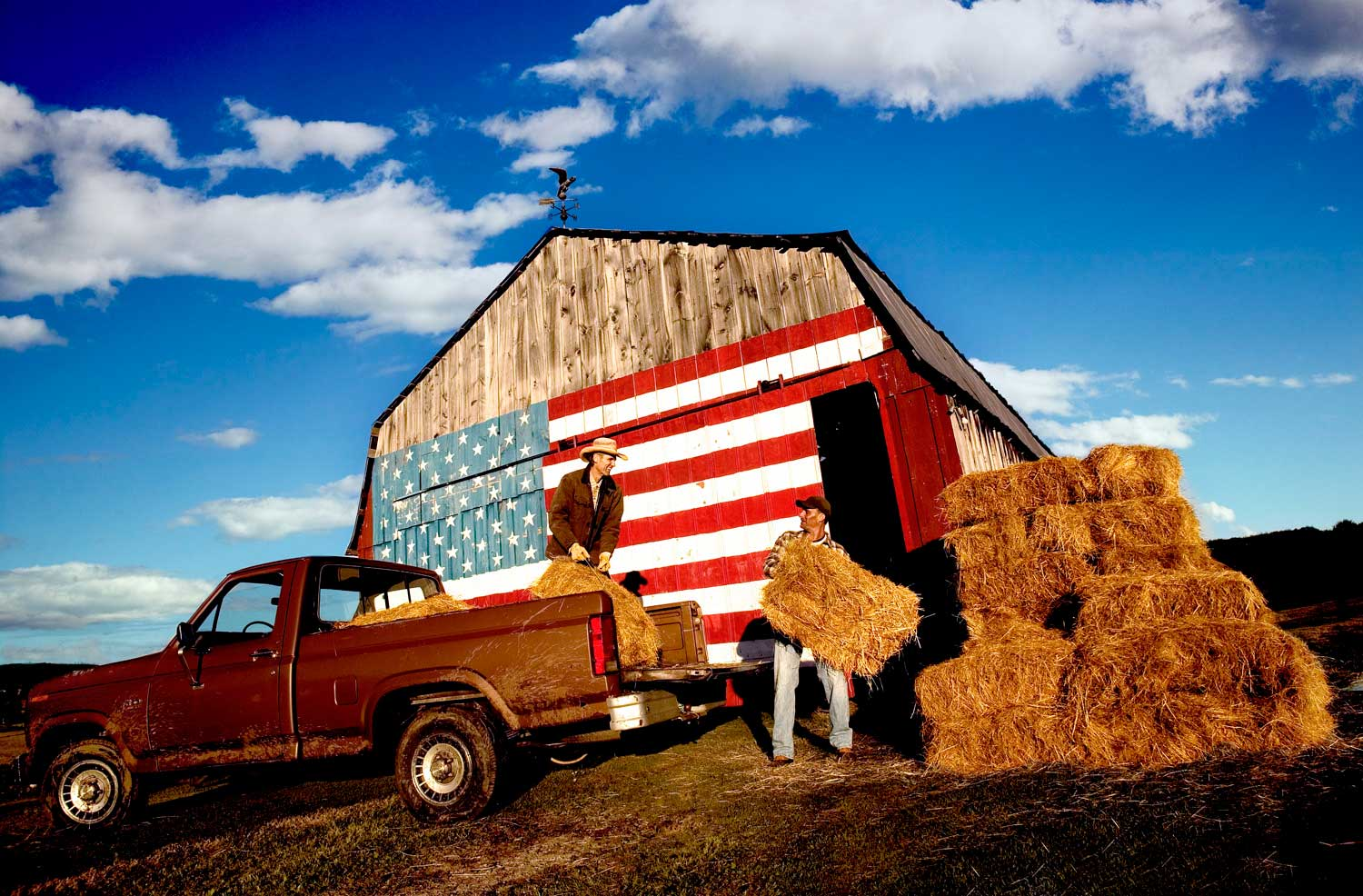 Skoal_Flag-farmers pitching haybales onto pickup truck