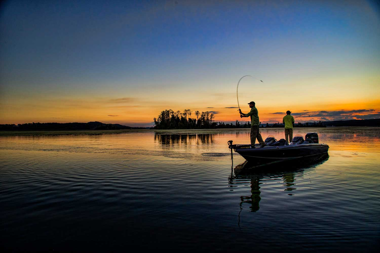 casting-fisherman-on-lake-at-sunrise