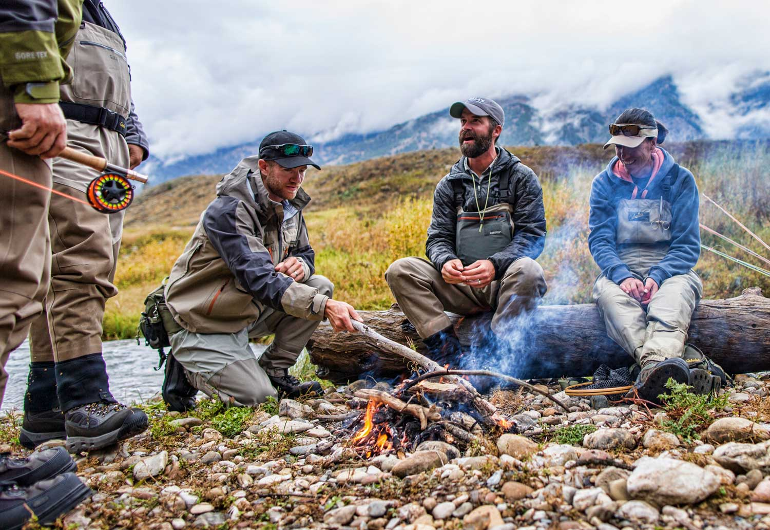 fly-fisherman-at-campfire-cooking-up-catch