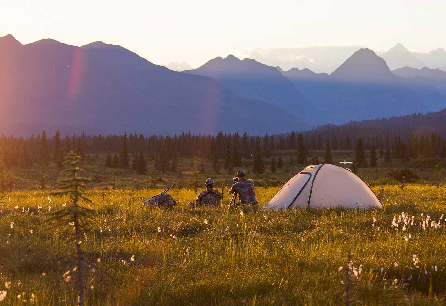 fly-fishermen-with-tent-in-mountains-at-sunset