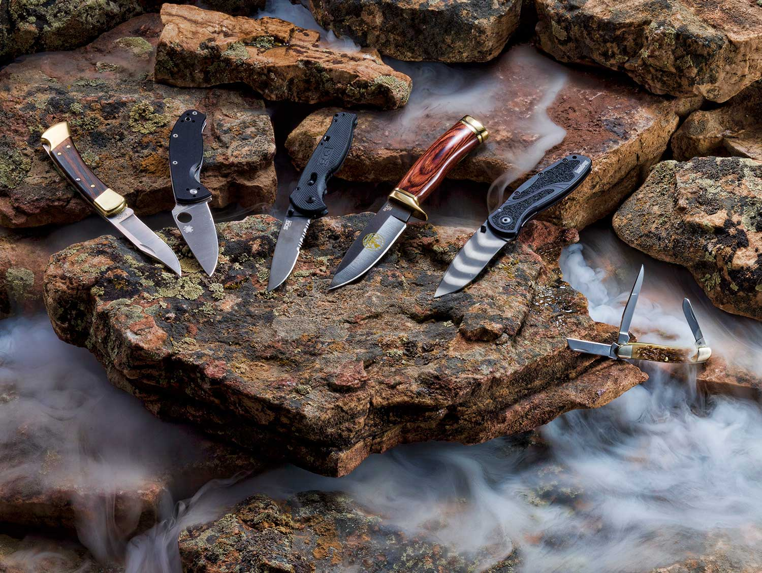 hunting knives still life on rocks