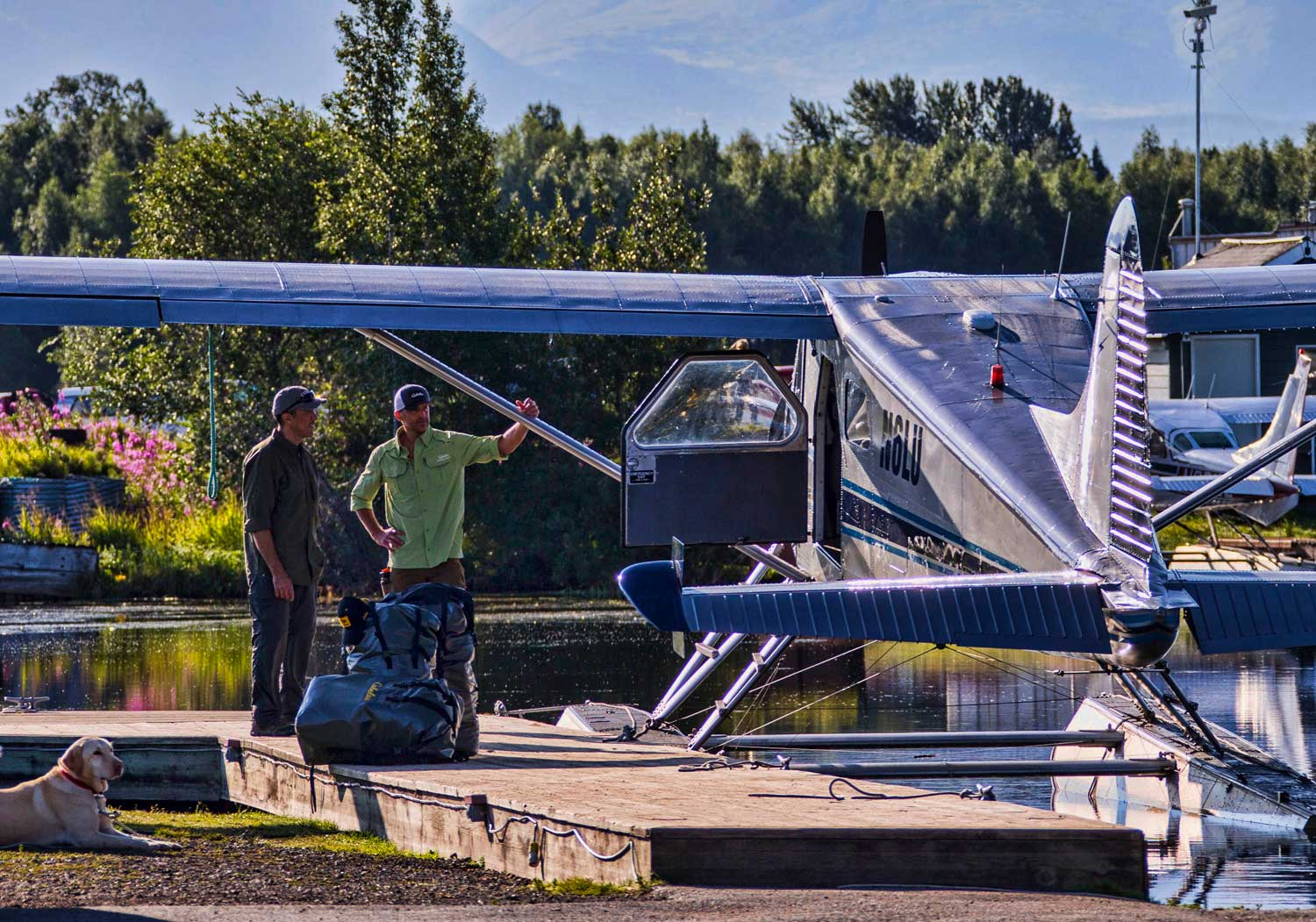 men-boardng-pontoon-plane-on-lake