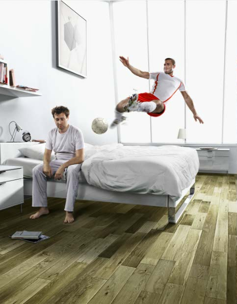 photo-imaging-man waking up in bed with soccer player kick