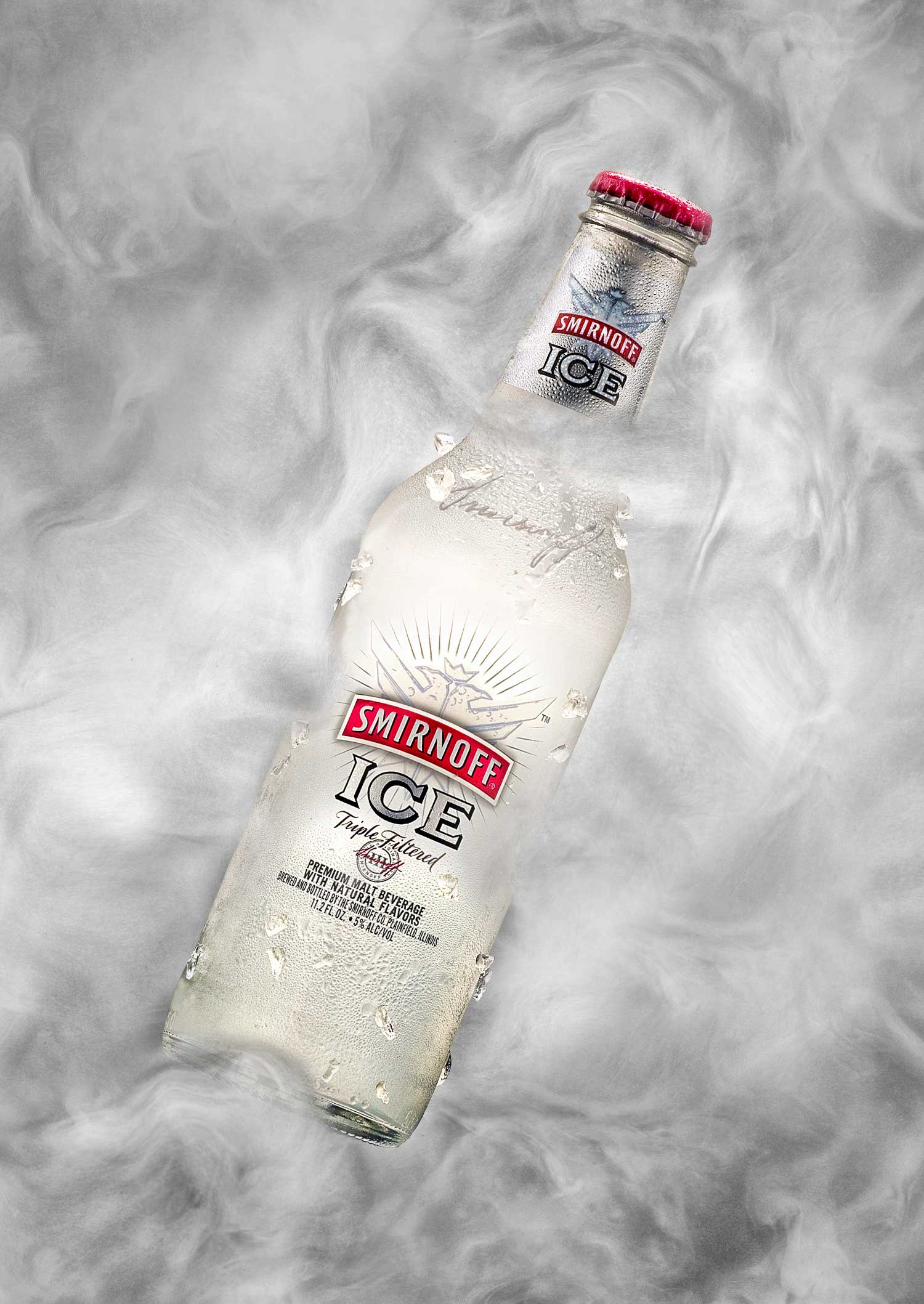 smirnoff ice bottle in smoky ice background