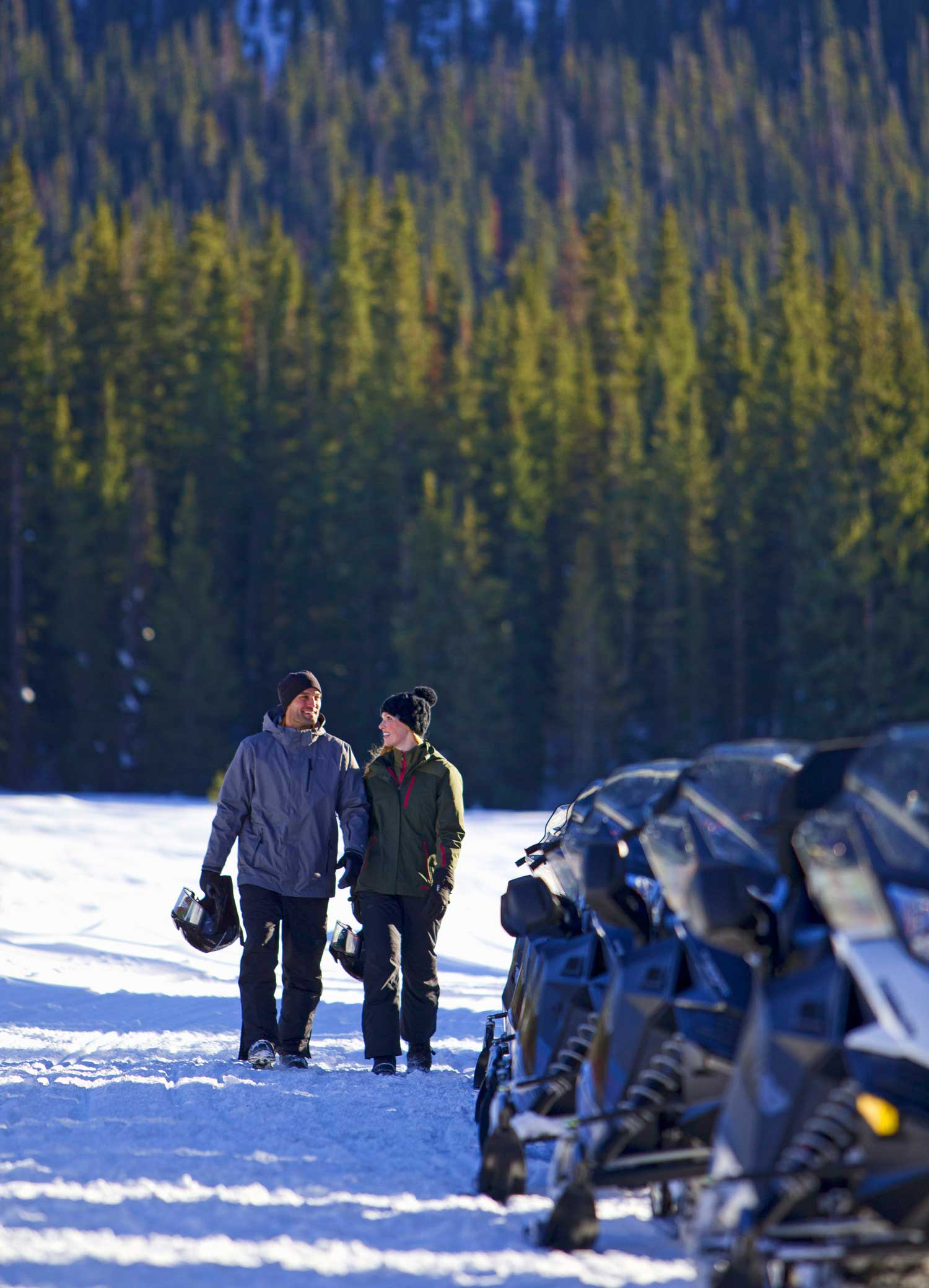 snowmobile-man-woman-couple--walking-to-snowmobile